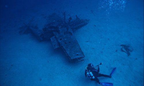 photo-of-person-scuba-diving-near-wreckage-3098969
